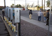 Mesa, Arizona - Day laborers wait on a street corner seeking work. Many are undocumented immigrants. Under a new Arizona law, employers can have their business licenses suspended or revoked if they ar... - Jim West - 25-01-2008