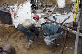 Mancelona, Michigan - Workers dismantle a natural gas drilling rig after drilling a well in the Antrim Shale field of northern Michigan. Michigan Basin - Jim West - 08-10-2008