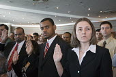 Detroit, Michigan - A woman from Bosnia (right) and a man from Gambia are among a group of immigrants sworn in as new U.S. citizens. - Jim West - 26-09-2008