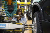 Lansing, Michigan - A worker tightens lug nuts on a wheel on the assembly line at a General Motors assembly plant which produces Buick, Saturn, and GMC vehicles. - Jim West - 01-12-2008