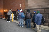 Washington, DC - Homeless men line up for breakfast at St. Matthew's Cathedral. - Jim West - 2000s,2009,America,American,americans,assistance,breakfast,Catholic,charitable,charity,Christian,cities,city,community service,DC,distributing,distribution,economic,economy,EQUALITY,excluded,exclusion