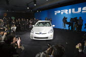 Detroit, Michigan - The 2010 Toyota Prius hybrid car is introduced at the North American International Auto Show. - Jim West - 2000s,2009,alternative,Alternative Energy,America,American,americans,Au,AUTO,AUTOMOBILE,AUTOMOBILES,Automotive,cameraman,capitalism,capitalist,car,Car Industry,carindustry,cars,Climate Change,Detroit,