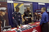 A young man considering the Marines, at a job fair, sponsored by the City of Detroit. - Jim West - 2000s,2009,African American,African Americans,agencies,agency,America,American,americans,apply,applying,armed,Armed Forces,army,BAME,BAMEs,banner,banners,Black,BME,BME Black minority ethnic American,b