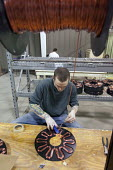 Manistee, Michigan - Workers assemble the generators of Windspire wind turbines. The Windspire is a small, vertical axis wind turbine designed for residential or small business use. It is being manufa... - Jim West - 24-04-2009