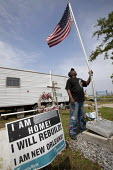 New Orleans, Louisiana, a Hurricane Katrina Survivor at the FEMA trailer park in the lower ninth ward, he has called home for the nearly four years since Hurricane Katrina destroyed his house. A monum... - Jim West - 26-03-2009