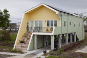 New Orleans, Louisiana - New homes built by Brad Pitts Make It Right organization in the lower ninth ward which was devastated by Hurricane Katrina. The homes are all elevated and use energy-saving te... - Jim West - 26-03-2009