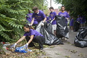 Young volunteers from St. Mary of the Hills Catholic Church collect trash and debris from an alley in Detroit's Corktown neighborhood, USA. - Jim West - 2000s,2009,adolescence,adolescent,adolescents,alley,America,bag,bags,BME Black minority ethnic American,boy,boys,catholic,child,CHILDHOOD,children,Church,churches,cities,city,clean,clean up,cleaning,c