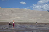 Tourists on Medano Creek in Great Sand Dunes National Park, USA. - Jim West - 06-07-2009