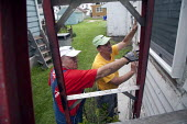 Volunteers from the United Methodist NOMADS group repair housing damaged in the 2008 Iowa flood. The NOMADS are retirees who volunteer their services for disaster recovery and other programs, USA. - Jim West - 2000s,2009,adult,adults,AGE,ageing population,America,assistance,BAD,charitable,charities,charity,christian,christians,church,churches,cities,city,damaged,DIA,disaster,disasters,ELDERLY,EXTREME,fix,fi