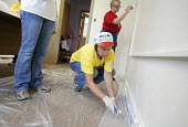 Volunteers paint St. James United Methodist Church, which was damaged in the 2008 Iowa flood, USA. - Jim West - 09-07-2009