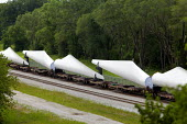 Fort Madison, Iowa - Newly manufactured wind turbine blades loaded on railway carriages leave the Siemens Energy, Fort Madison Blade Plant. - Jim West - 08-07-2009