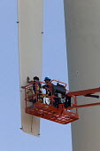 Boulder, Colorado - Wind power research at the National Renewable Energy Laboratory Wind Technology Center, a unit of the US Department of Energy. Workers attach sensors to one of the blades of a wind... - Jim West - 07-07-2009