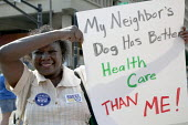 SEIU Union members campaign for healthcare reform during the Labor Day parade. Indianapolis, Indiana, USA. My neighbor's dog has better healthcare than me! - Jim West - 05-09-2009