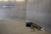 Washington, DC - A homeless man sleeps at the entrance to a Metro subway station near the White House. - Jim West - 2000s,2009,African American,African Americans,African-American,America,asleep,BAME,BAMEs,black,BME,bmes,capital,cities,city,cultural,DC,diversity,DOWNTURN,economic,economy,entrance,EQUALITY,ethnic,eth