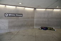 Washington, DC - A homeless man sleeps at the entrance to a Metro subway station near the White House. - Jim West - 18-09-2009