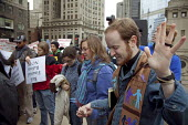 Chicago, Illinois - David Weasley, pastor of First Baptist Church of Berwyn, Illinois, leads a prayer vigil at the start of a rally of Trades union members and community organizations rally outside th... - Jim West - 27-10-2009