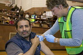 Hamtramck, Michigan - A healthcare worker vaccinates a man against the H1N1 swine flu. - Jim West - 24-10-2009