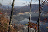 Sylvester, West Virginia USA- The coal sludge impoundment pond at Massey Energys Elk Run complex. Impoundments hold liquid and solid wastes from the coal mining process, including toxic chemicals that... - Jim West - 09-11-2009