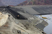 Sylvester, West Virginia USA- A bulldozer spreads coal sludge on a coal impoundment dam at Massey Energys Elk Run complex. Impoundments hold liquid and solid wastes from the coal mining process, inclu... - Jim West - 09-11-2009