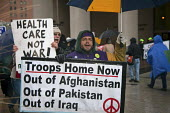 Detroit, Michigan - Anti-war activists protest at the Federal Building in Detroit to protest against President Obama's plan to send 30,000 more troops to Afghanistan. - Jim West - American,2000s,2009,ACTIVIST,activists,Afghanistan,against,America,American,americans,anti war,Antiwar,anti-war,Building,BUILDINGS,CAMPAIGN,campaigner,campaigners,CAMPAIGNING,CAMPAIGNS,care,DEMONSTRAT