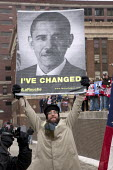 Detroit, Michigan - A follower of the Lyndon LaRouche movement or cult, carries a poster portraying Democrat President Barack Obama as the Nazi Adolf Hitler. - Jim West - , American,2010,2010s,America,American,americans,cult,Detroit,FACISM,FACIST,FACISTS,far right,far right,FASCIST,FASCISTS,Hitler,LaRouche,Lyndon,Michigan,movement,Nazi,NAZIS,Obama,pol,political,POLITIC