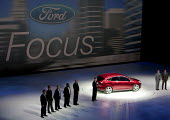 Detroit, Michigan, Ford executives introduce their new Ford Focus at the 2010 North American International Auto Show. CEO Alan Mulally is at the left of the car, and chairman Bill Ford Jr. is on the r... - Jim West - 2010,2010s,Alan Mulally,America,American,americans,auto,AUTOMOBILE,AUTOMOBILES,Automotive,automotive industry,Bill Ford,boss,bosses,capitalism,capitalist,car,Car Industry,carindustry,cars,Detroit,EBF,
