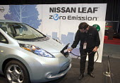 Detroit, Michigan - The Nissan Leaf plug-in electric car on display at the 2010 North American International Auto Show. - Jim West - 2010,2010s,Alternative Energy,America,American,americans,auto,AUTOMOBILE,AUTOMOBILES,Automotive,batteries,battery,capitalism,capitalist,car,Car Industry,carindustry,cars,charger,charging,charging poin