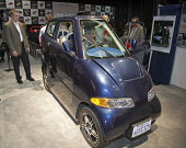 Detroit, Michigan - The Tango, an electric car manufactured by Commuter Cars, on display at the 2010 North American International Auto Show. The car is 39 inches wide. It seats two (one behind the oth... - Jim West - 2010,2010s,adult,adults,Alternative Energy,America,American,americans,auto,AUTOMOBILE,AUTOMOBILES,Automotive,automotive industry,batteries,battery,capitalism,capitalist,car,Car Industry,carindustry,ca