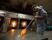 Detroit, Michigan - Paul Abowd works on a glass bowl at the Michigan Hot Glass Workshop. - Jim West - American,2010,2010s,adult,Adult Education,adults,America,American,americans,art,artisan,artist,ARTISTS,blow,blower,blowing,blowpipe,class,craft,crafts,craftsman,Detroit,edu,educate,educating,education