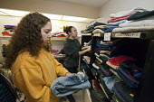 "Fowlerville, Michigan - Teenagers from St. Johns Lutheran Church sort donated clothing for the needy at the Family Impact Center. They were participating in World Visions ""30-Hour Famine."" In this pro... - Jim West - 27-02-2010"