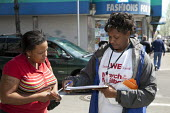 A worker for the U.S. Census Bureau talks to a woman on a street about the importance of returning the 2010 Census questionnaire. - Jim West - 10-04-2010