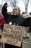 A protester dressed as Obama with claws and fangs, at a Tea Party Express rally in Detroit. - Jim West - 2010,2010s,activist,activists,against,America,American,americans,campaign,campaigner,campaigners,campaigning,CAMPAIGNS,claw,claws,conservative,conservatives,costume,costumes,DEMONSTRATING,demonstratio