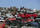 Cars crushed and ready for recycling at a scrapyard. - Jim West - 10-04-2010