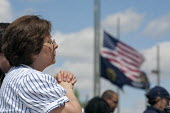 A woman prays during a National Day of Prayer observance at City Hall - Jim West - 06-05-2010