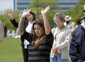 Women pray during a National Day of Prayer observance at City Hall. - Jim West - &,2010,2010s,America,belief,christian,Christianity,christians,cities,city,conviction,Day,evangelical,faith,FEMALE,god,gospel,hall,LIFE,male,man,men,monotheistic,National,of,people,person,persons,pray,