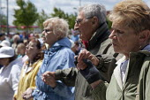 People praying during a National Day of Prayer observance at City Hall. - Jim West - 06-05-2010