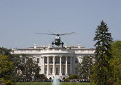Marine One helicopter takes off from the White House lawn. - Jim West - 1,2010,2010s,ACE,air transport,aircraft,aircrafts,America,aviation,buildings,cities,city,culture,fly,flying,government,helicopter,helicopters,House,houses,journey,journeys,lawn,Marine,Obama,One,pol,po