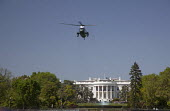 Marine One helicopter takes off from the White House lawn. - Jim West - 1,2010,2010s,ACE,air transport,aircraft,aircrafts,America,aviation,cities,city,culture,fly,flying,government,helicopter,helicopters,House,houses,journey,journeys,lawn,Marine,Obama,One,pol,pol politics
