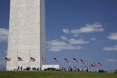 Flags and tourists around the Washington Monument. - Jim West - 19-04-2010