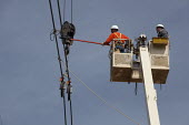 Electricity engineers installing a high voltage power line using a mobile lift platform, Amissville, USA - Jim West - 20-04-2010