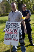 Pro-gun activists openly carry firearms in a pro-gun rally at Fort Hunt. With a yellow ribbon. - Jim West - 19-04-2010