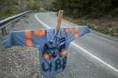 A coal miners shirt hangs by the road as a memorial to the 29 miners killed in the explosion at Massey Energys Upper Big Branch mine. - Jim West - 2010,2010s,accident,accidental,accidents,America,Big,Branch,BRANCHES,coal,coalfield,collieries,colliery,country,countryside,dead,death,deaths,dia,dia accident accidents disaster disasters,died,disaste
