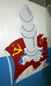 Artwork and political commentary on the wall of the underground launch control center for Minuteman II missiles showing a missile breaking through a Soviet flag. The silo, known as launch facility Del... - Jim West - American,2010,2010s,ACE,against,Air,Air force,Airforce,America,American,americans,anti,Armed Forces,arms,art,arts,assured,atomic,bomb,bombs,cartoon,CARTOONS,CCCP,center,Cold War,communism,Communist Pa