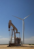 An oil well and wind turbines in west Texas. USA - Jim West - 13-10-2010