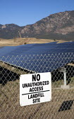 A solar photovoltaic facility on contaminated land generating renewable energy. The solar farm was built on top of a former landfill site at the U.S. Army's Fort Carson. USA - Jim West - 05-10-2010