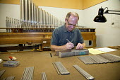 A worker making parts for a pipe organ, Reuter Organ Company, USA - Jim West - 14-10-2010