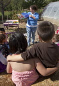 Americorps volunteer talks to elementary school children at the Polston Community Garden in Colorado's San Luis Valley about where food comes from. USA - Jim West - &, American,2010,2010s,agency,Alamosa,America,American,americans,Americorps,belief,boy,boys,charitable,charity,child,CHILDHOOD,children,christian,christianity,christians,class,collaboration,collaborat