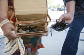 Detroit, Michigan - Two woman display handguns, one in a handbag, that they plan to turn in to the Detroit police department in a gun buyback program. Residents were paid $25 to $200, depending on the... - Jim West - 30-08-2011