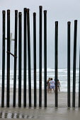 San Ysidro, California, Fence at Border Field State Park separating the USA and Mexico at a beach at the Pacific Ocean - Jim West - 03-07-2011