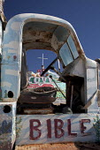 An old truck painted with religious slogans at Salvation Mountain, a desert hillside covered with religious messages, created by Leonard Knight. USA. - Jim West - 28-01-2012